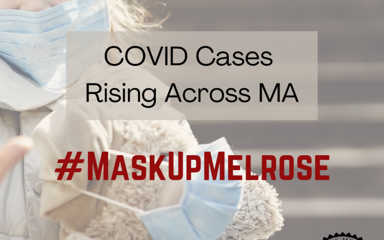 Little girl wearing a mask and holding a teddy bear also wearing a mask. Text reads: Covid Cases Rising Across MA #MaskUpMelrose